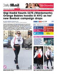 press: gigi hadid flaunts wardements orange babies hoodie for a good cause